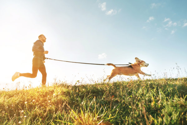 Man Running With Dog on Leash - Neil King Physical Therapy