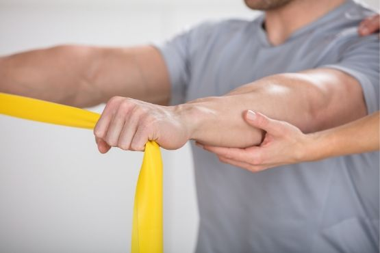 Elastic Band Stretching With Arms - Neil King Physical Therapy
