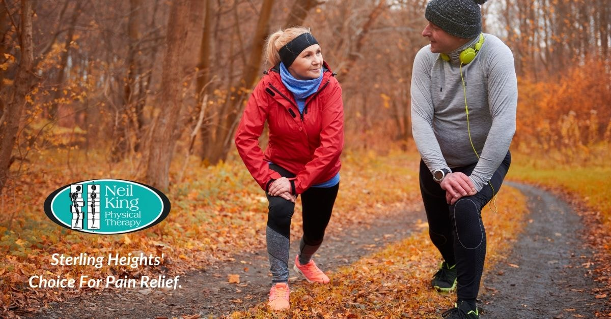 Man and Woman Stretching For A Fall Run - Physical Therapy Near Sterling Heights - Neil King Physical Therapy