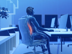 3d rendered illustration of a man working on a pc - having a painful back